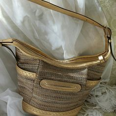B Makowsky beautiful hobo bag Beautiful bag by b.makowsky all gold leather trim woven fabric  Side Pockets onezip inside pocket two pockets on the inside feet on the bottom, excellent condition beautiful gold colors b Makowsky  Bags Shoulder Bags
