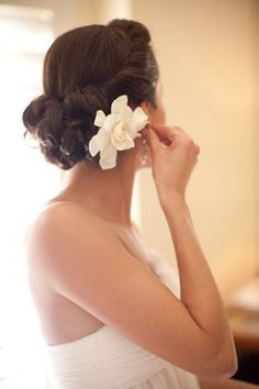 A romantic chignon with an ivory flower (Photo by Briana Marie Photography)