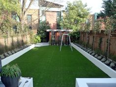 modern minimalist garden design low maintenance high impact garden design raised white wall beds grey decking east grass lawn turf sunken garden with fire and chimney flat trees balham wandsworth london (13)
