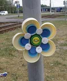 plastic bottle cap flower big beige by FVue, via Flickr.  These would look so cool on Playcentre's fence!!!