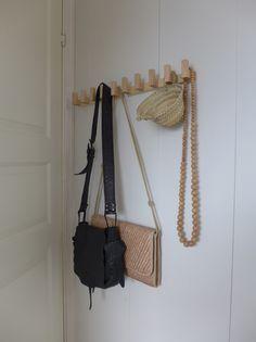 natural wood geometric coat rack