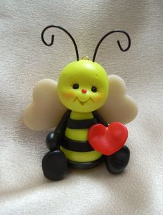 honey bee bumblebee bee polymer clay insect bug sculpture figurine gift. $12.25, via Etsy.