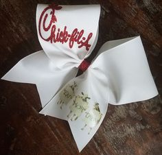 Chick-Fil-A Cheer Bow/Softball Bow/Dance Bow 3 inch wide white ribbon with Glitter Red Chick-fil-a and iron on Cows (Eat More Chicken) Hair tie attached. Bows are made stiff. Cheerleading Bows, Cheer Bows, Dance Bows, Lords Supper, Graduation Hairstyles, Big Bows, Softball, Drink Sleeves, Outfit Work