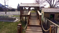Swing bridge leading to fort. Made from macrocapra, manuka balustrades and cedar shingle roof.