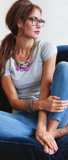 love the total look of this.. simple hair, glasses, Tshirt with jeans and a beautiful art piece of an necklace to make it all 'fancy'