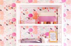 Flower wallpaper behind open shelf