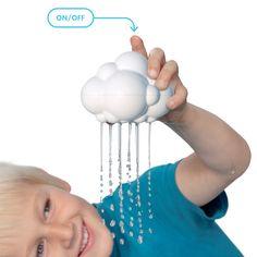 Boy playing with the Moluk rain cloud