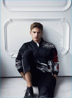Bo Develius relaxes in a printed bomber jacket and virgin wool trousers for Emporio Armani's cruise 2017 campaign.
