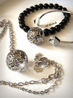 Origami Owl studded bangle & Lisa Hoffman beaded bracelet & necklace.  Simple & sophisticated! Add a touch of fragrance beads to the bracelet and necklace available on the site too. #limitededition #jewelry #origamiowl #bracelet #fragrancejewels #silverjewelry #blackjewelry