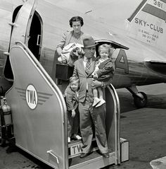 "An unidentified family just arriving at the airport on a Transcontinental & Western Airlines ""Sky-Club"" flight"