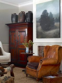 """(via Barbara-Westbrook-Atlanta-Bungalow-via-Garden-and-Gun-Armoire-for-the-TV-painting-over-fireplace.jpg (700×944)) """