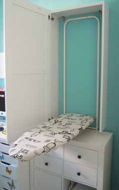 Ironing board cabinet - hang our over the door iron on the wall instead of the the door. Also instead of Ironing board remove lower drawers and a sewing table comes down! Sewing Room Design, Laundry Room Design, Sewing Rooms, Diy Sewing Table, Diy Table, Inspiration Dressing, Ikea Ironing Board, Laundry Room Storage, Laundry Rooms