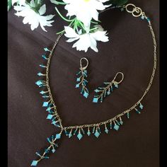 """Handmade Necklace & Earrings Handmade with blue and light blue beads on silver tone chain. Necklace drop is 11"""".   Earrings measure approx 1.5"""". Truly unique one of a kind set. Jewelry Necklaces"""