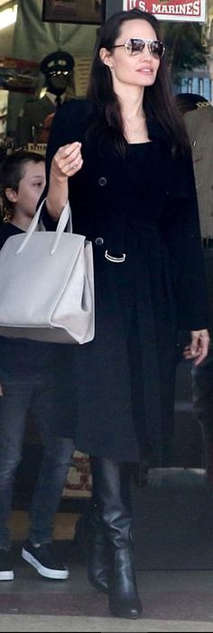 Angelina Jolie wearing Saint Laurent and Aquatalia