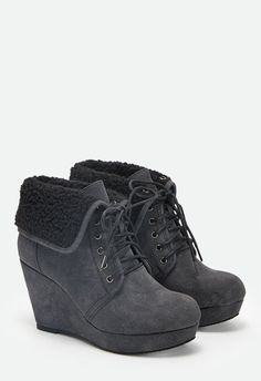 """Bundle-up with Genesis! She's your ideal winter bootie in that she has a 3.5"""" heel on top of a 1"""" platform and lace-ups that lead to an adjustable shaft with faux shearling lining. Look good and feel good while you're cozying up to your hot chocolate and your boo! ..."""