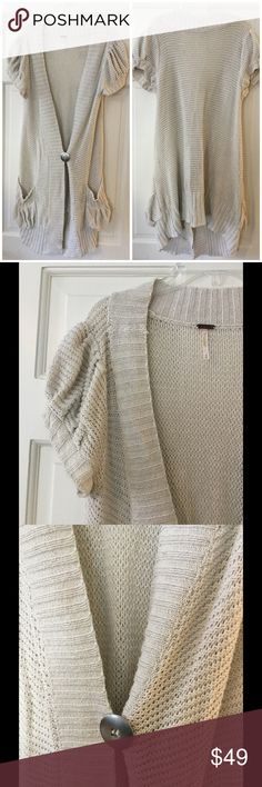 """Free People puff sleeve Metallic Duster Cardigan This beautiful cardigan features short puffed sleeves, pouch pockets, and a single button closure. Cotton/polyester. Hand wash.  Underarm across 17"""". Length 34"""". Excellent condition. EUC. Free People Sweaters Cardigans"""