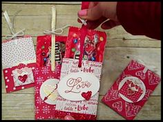 "Hi Everyone! Here's a Valentine's Treat Holder that is interactive. When you pull up on the ribbon, it also pulls up the treat inside! The fun pack of M & M's were used. The paper is from the upcoming Sending Love Designer Series Paper Stack available January 4th. You can also use this design to include a note...it's no calorie that way! Video uploading this am and will be posted here soon! UPDATE - See tutorial below! Materials: 4"" x 6"" Designer Paper scored along the 6"" side at 1/2"" 14""…"