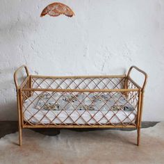 Vintage rattan crib seen at www.thefanzynet.com
