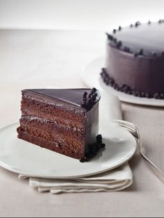 CHOCOLATE TRUFFLE CAKE An edible masterpiece of chocolate, with subtle orange flavor, this cake is the perfect finale to a very special dinner. Layers of dark chocolate cake alternate with whipped ganache, all coated with a shiny glaze.