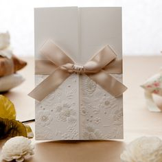 """Elegant Embossed Ivory Folded Ribbon Wedding Invitations//Use coupon code """"rpin"""" to get 10% off towards all the invitations. #elegantweddinginvites"""