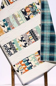 Ready to ship! This modern baby quilt is truly unique and one of kind! With a scrappy feel using only the highest quality quilting fabrics it can not be duplicated exactly. If you see one you like get it while you can! It measures approximately 37 by 56 perfect for a baby to grow