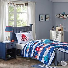 Magical sea creatures frolic on the blue and white nautical stripes of this Mi Zone Kids Sealife Coverlet Set to delight and lull your child to sleep. Featuring matching pillow sham(s), whale patterned sheets, and a smiling crab throw pillow.