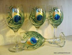 How to Paint on Glass, Hand Painted Peacock Feather Wine Glasses from The Dollar Store DIY | Lucy Designs