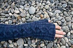 Arden is unisex elbow-length hand-warmer that uses a single skein of Malabrigo Worsted. One large cable is accented by single ribbing and smaller twisted cables, which can be easily knit without a cable needle, making Arden a fast, engaging project.