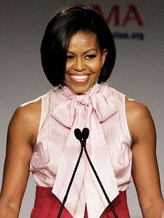 The First Lady looked ultra-chic in a L'Wren Scott pink and white tie-neck top