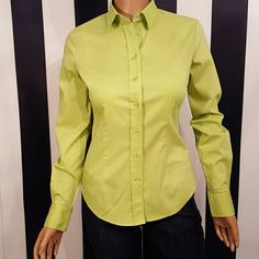 New York & Company Size XS This awesome summer shirt is fitted to show off your shape. It is a beautiful lime green and would add color to any outfit. Beautiful button detail at cuff. Darts in both the front and the back. 60% cotton, 35% polyester and 5% spandex. New York & Company Tops Blouses