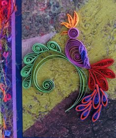 Quilled Jacobean Bird by all things paper, via Flickr -- love the background paper as well.