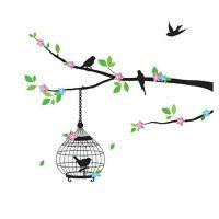 Decowall muursticker vogels op tak met roze bloemen en vogelkooi