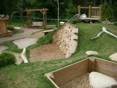 natural playground - love this! Wonderful arrangement for a sloping park site and good use of space