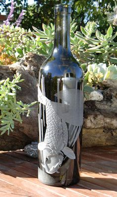 Koi Graphic design has a multi - staged carved / sandblasted effect onto empty wine bottles. All bottles can be transform ed into oil lamps, as well as olive oil dispensers. Empty Wine Bottles, Wine Bottle Candles, Glass Bottles, Etched Glass, Glass Etching, Cut Glass, Olive Oil Dispenser, Bottle Cutting, Glass Engraving