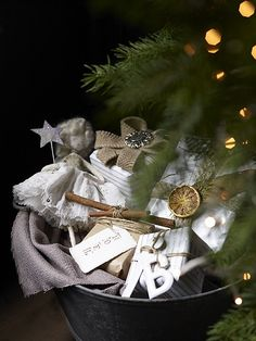 Such a cute way to decorate under the tree with all the ornaments and other decorations we all collect but don't want to clutter up the tree with. Or you could do this instead of an Advent calendar and wrap 25 little gift boxes or something and pull one out each day. Super adorable and versatile!