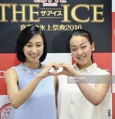 Figure skater Mao Asada (R) and her sister Mai pose for a photo during a press conference in Nagoya on June 1, 2016, for a three-day ice show beginning Aug. 5 in the central Japan city.