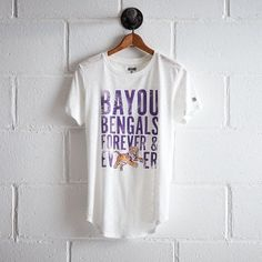 Tailgate LSU Forever T-Shirt ($20) ❤ liked on Polyvore featuring tops, t-shirts, white, vintage jerseys, ripped t shirt, distressed vintage tees, slim fit t shirts and distressed white t shirt