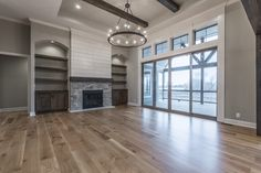 Built-ins, Fireplace, Shiplap, Natural Hardwood Floors, Natural Stain Color, Sliding Glass Doors, Light Fixtures, Beams, Coffered Ceiling, Reverse Floorplan