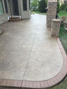 Stamped patio w/ 2 sets of landings/steps w/ matching brick borders & facing on landings/steps.