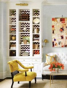 Love - Chevron behind shelves. And pillow. And sofa on back wall with shelves on either side in living room? Picture light and coffee table; maybe rug.... But not a tufted sofa!