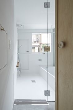 button on the door, really cute. House in Itami / Tato Architects