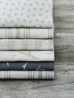 Peony and Sage - Coastal Fabric Collection - Folds of six different fabrics with checks, bird prints, star prints and stripes in light grey, beige, white and dark blue Coastal Bedrooms, Coastal Living Rooms, Coastal Cottage, Coastal Homes, Coastal Style, Coastal Decor, Beach Homes, Tropical Decor, Roman Blinds