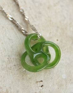 Carved Jade Necklace - Knot - Mini Circle of Life - Sterling Silver. $150.00, via Etsy.