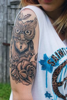 This is the idea I have! Something different though: one owl on each thigh...each with a different color scheme [one girly and one more masculine]...the girly owl will be holding the heart locket in her beak [like this one] and the masculine one will be holding the key [like this one]. :) Each will have the huge, ornate roses underneath them. :) Now, I just need to design it...