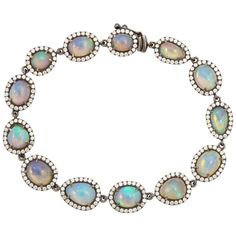 Opal Diamond Gold Bracelet. 18kt blackened gold, opal (13=app. 8cts) and diamond (app. 2cts) bracelet. The blackened gold creates a dramatic contrast against the multicolor opals and diamonds, c 2014