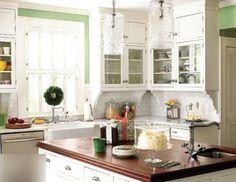 Beautiful kitchen design with white shaker kitchen cabinets, white carrara marble subway tiles backsplash, silestone quartz counter tops, polished nickel faucet and bamboo roman shade.