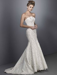 Strapless dropped waist trumpet / mermaid organza wedding dress