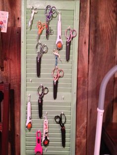 hung a shutter to hang scissors and rotary cutters