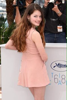 Mackenzie Foy from Twilight saga long hair over the shoulder glance smile