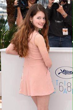 Mackenzie Foy from Twilight saga long hair over the shoulder glance smile